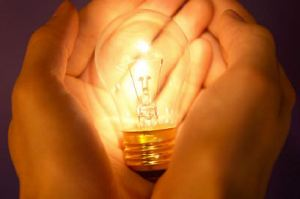 Idea: Hands holding a lightbulb